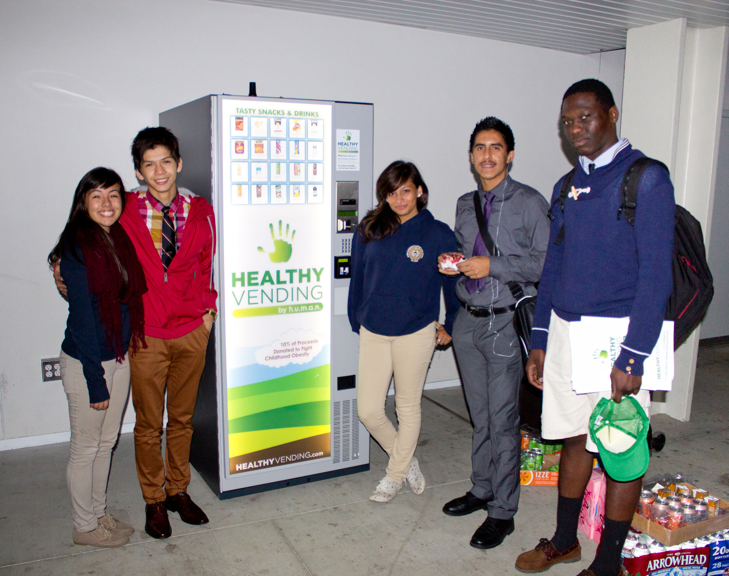 Animo Leadership Academy Students Stand Next to a HUMAN Healthy Vending Machine